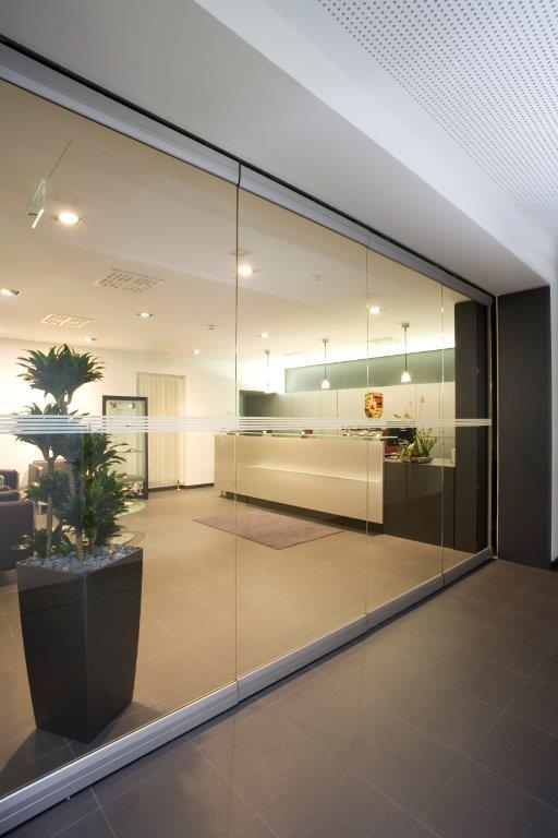 Photo of glass sliding doors in an office