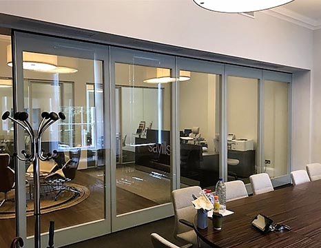 Photo of a moving glass partition in an office