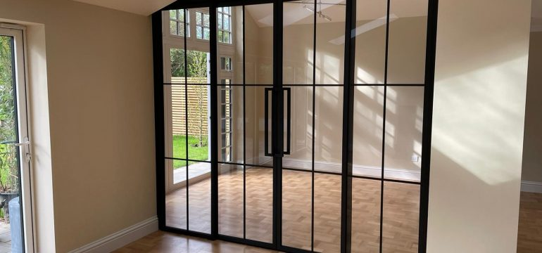 crittall glazed acoustic sliding doors. wall partitions